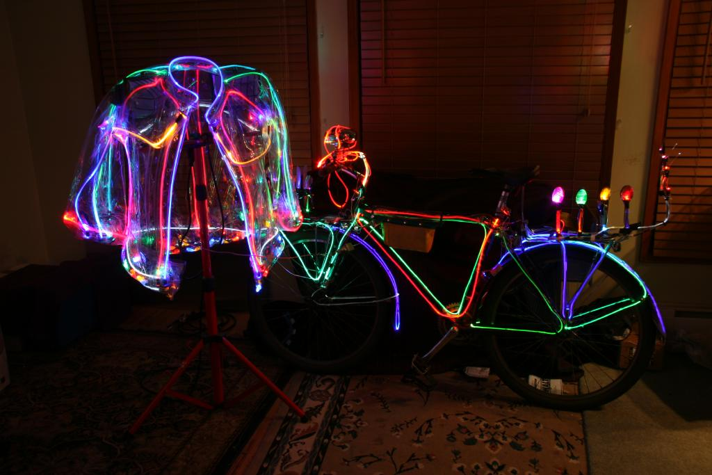 Wear a light up jacket and ride a light up bicycle for maximum safety